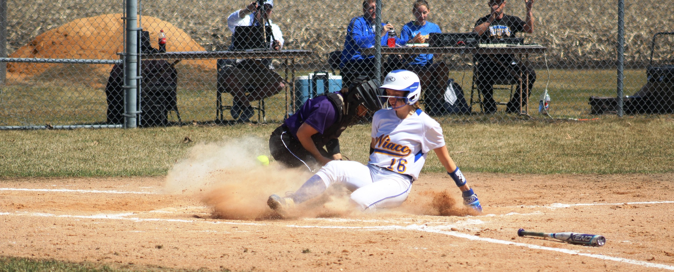 NIACC's Morgan Thesing-Ritter slides in safely at home after hitting an inside-the-park home run in the third inning of Wednesday's first game against Ellsworth.