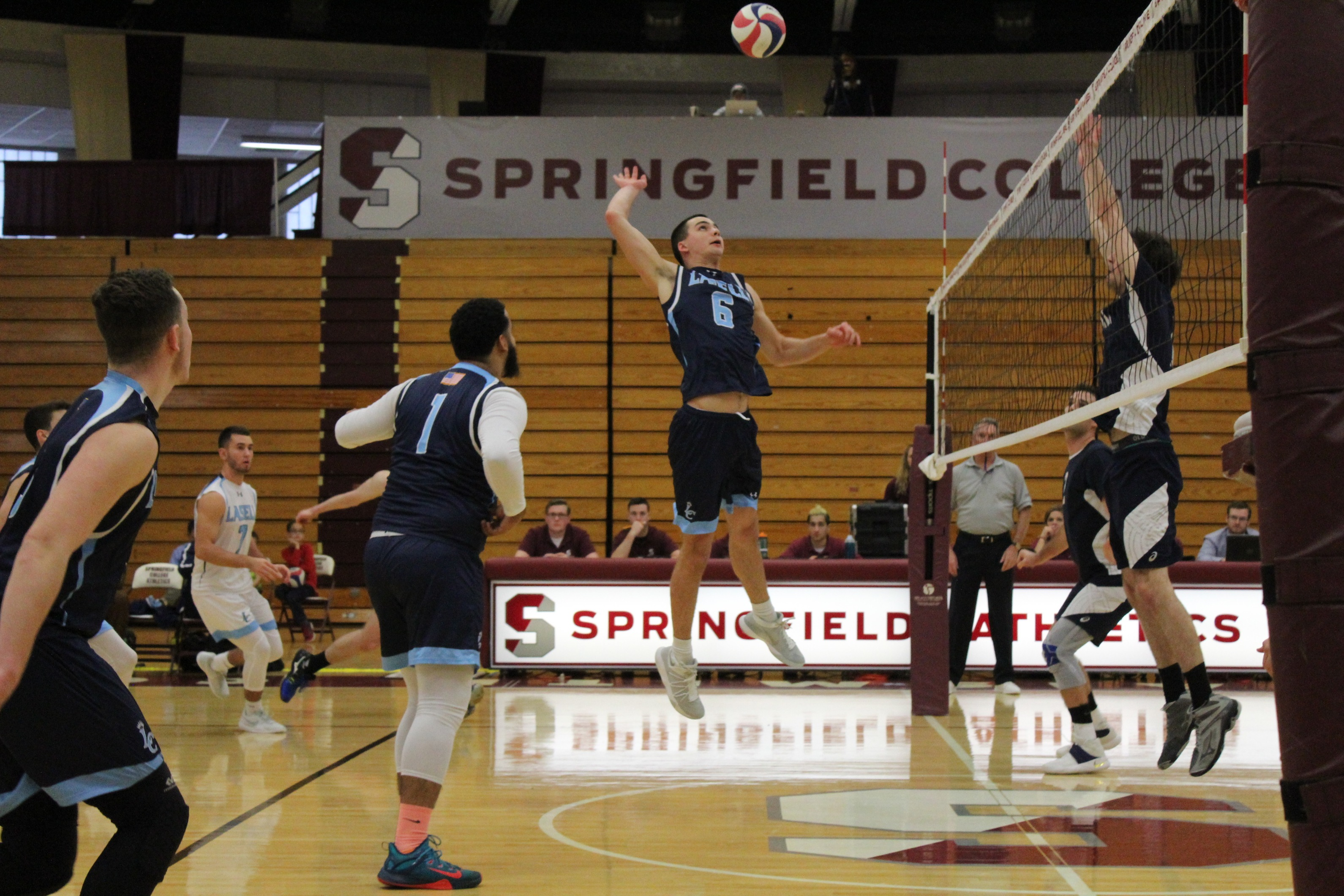 Lasell Men's Volleyball upended by Rivier