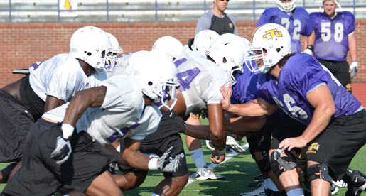 Golden Eagle players go through a blocking drill earlier in the week; Come Sunday they'll scrimmage