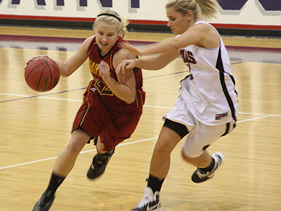 FSU's Sarah DeShone drives with the ball in Wednesday's victory at St. Joseph's (Photo Courtesy Fr. Tim McFarland CPPS)
