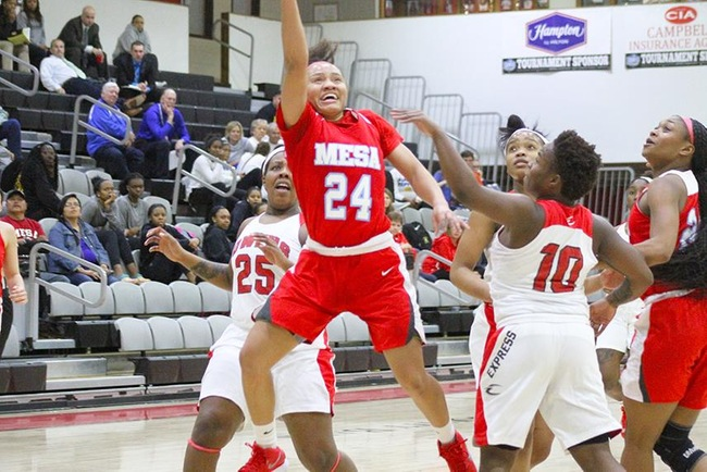 Takara Wade powers to the hole to score two of her career high 22 points against Owens College during the NJCAA National Tournament Thursday night. (Photo by Aaron Webster)