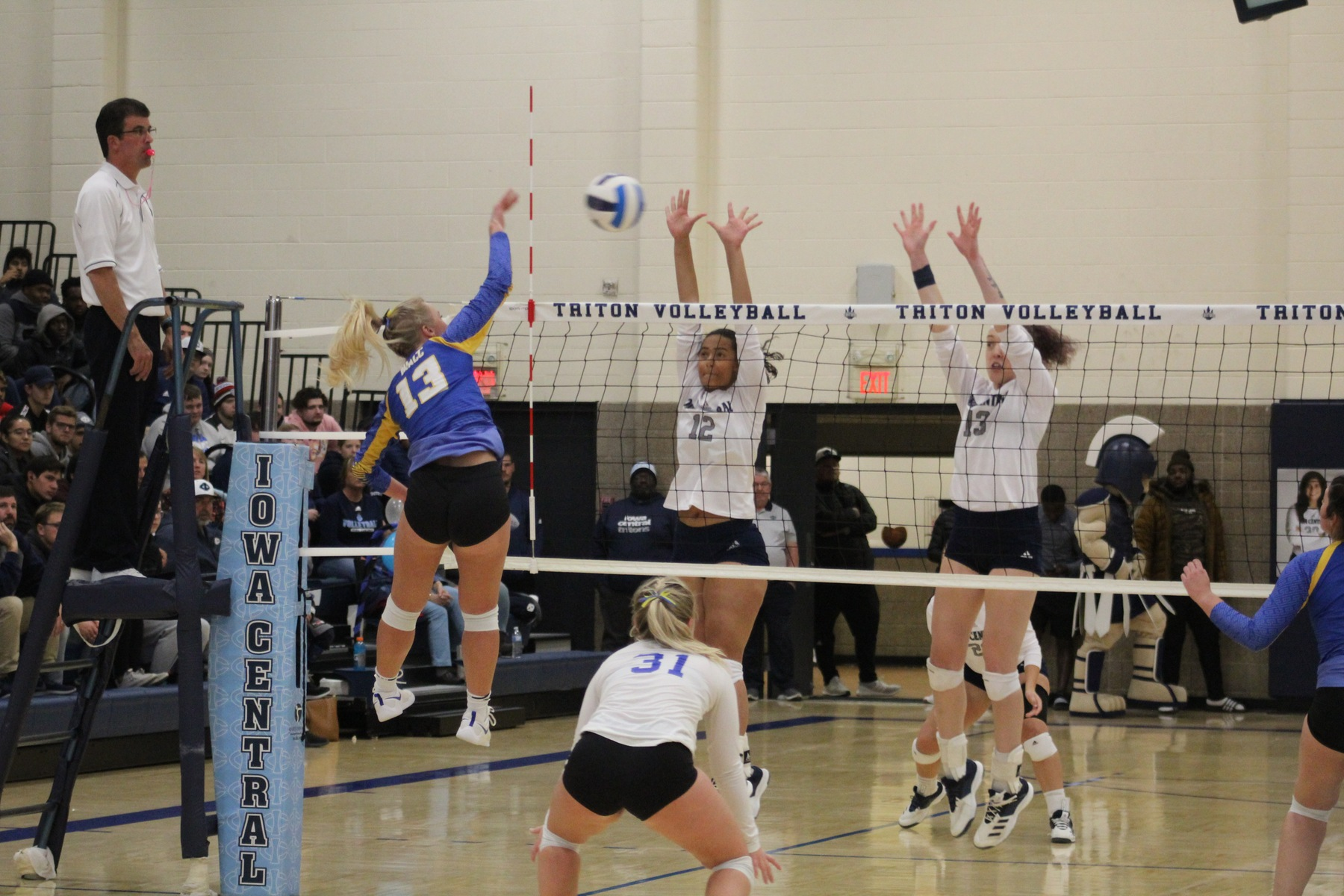 Alexa Loftus hits the ball over the net in Wednesday's match at Iowa Central.