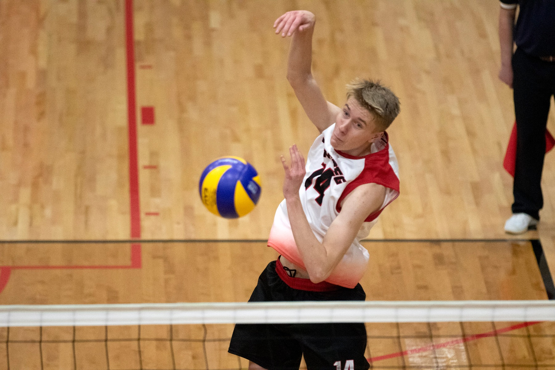 Liam Kristjanson swings on a ball off the net during Winnipeg Wesmen men's volleyball action against the UBC Thunderbirds, Oct. 20, 2019. (David Larkins/Wesmen Athletics)