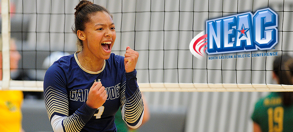 Darriyan Thomas, pictured left, is excited after scoring a point in a volleyball match. Her fists are pumped as she screams for joy. A NEAC logo is in the upper right corner. There is a volleyball net behind Thomas.
