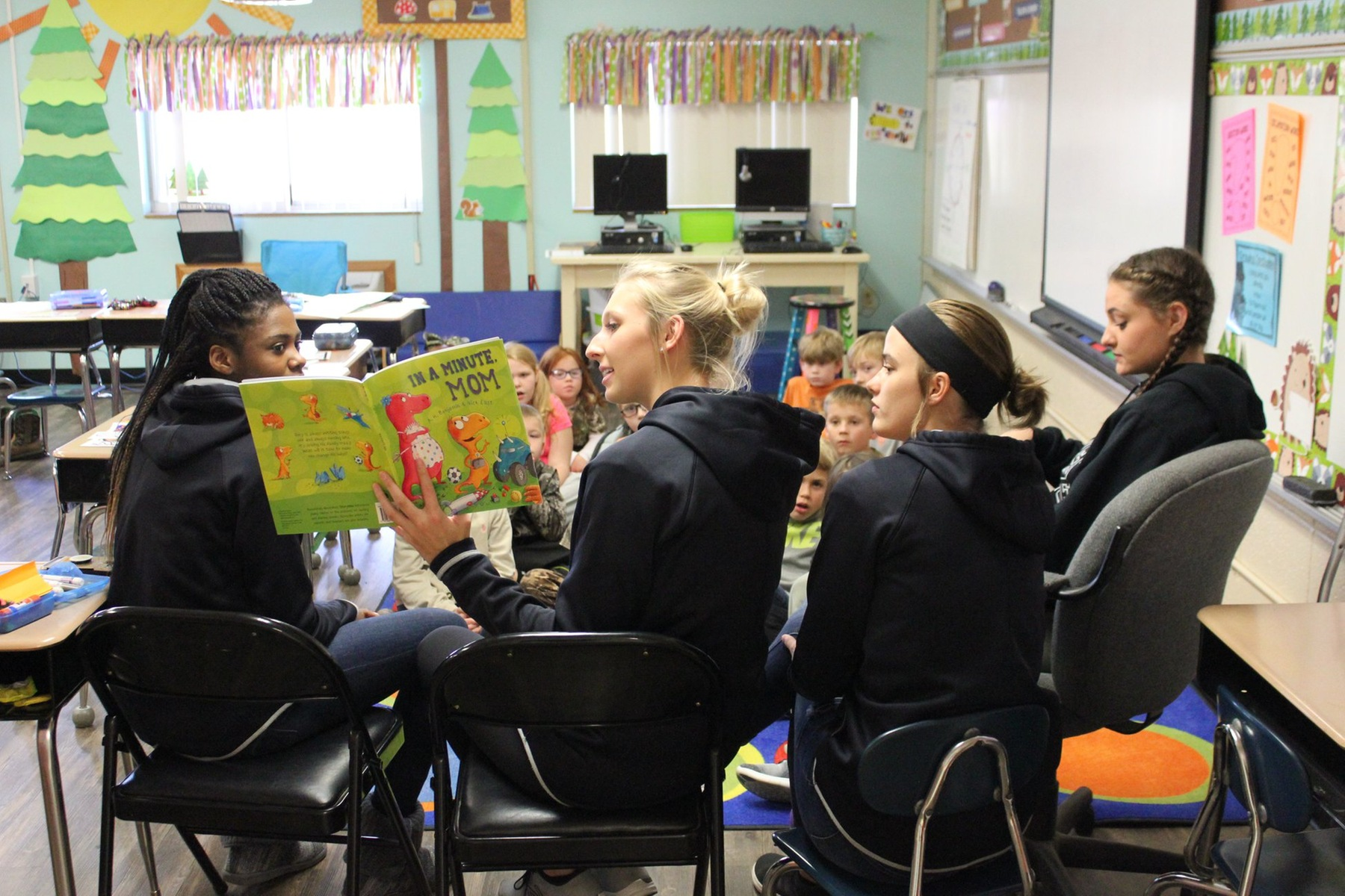 Kids take aim at reading during Qulin's DEER Day