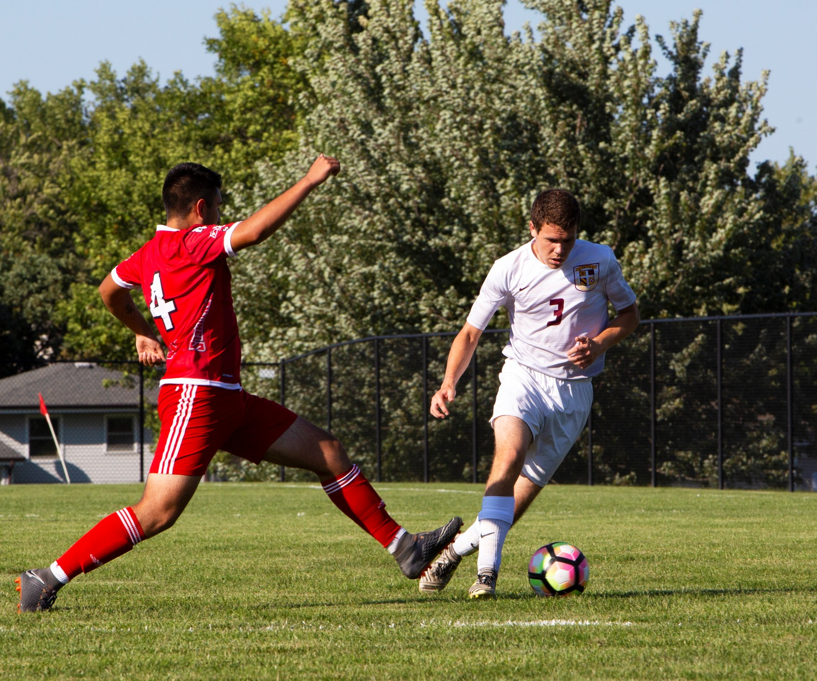 Faith sophomore Jacob Stilwell eludes a Nebraska Christian defender. The Eagles won, 3-1, to improve to 2-1 on the season.