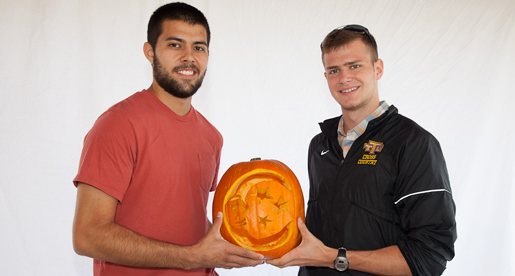 Men's cross country captures carving contest crown; Pumpkins to be gifts