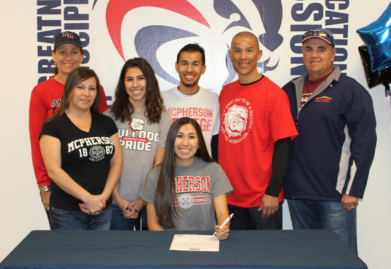 Aryana with her family, high school coach, and ARC Coach Powless