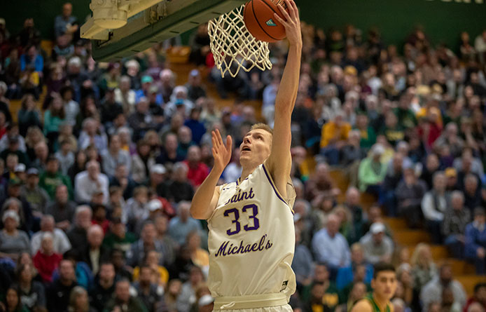 Men's Basketball Stays with Division I Vermont Before Falling in Exhibition