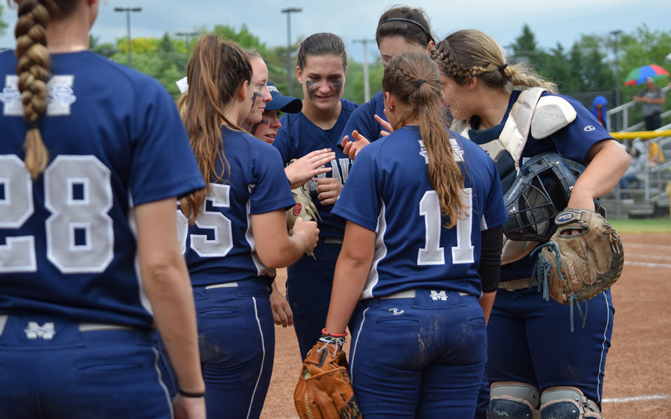 The Greyhounds talk between innings during the 2018 NCAA Division III Super Regional at Rowan University.