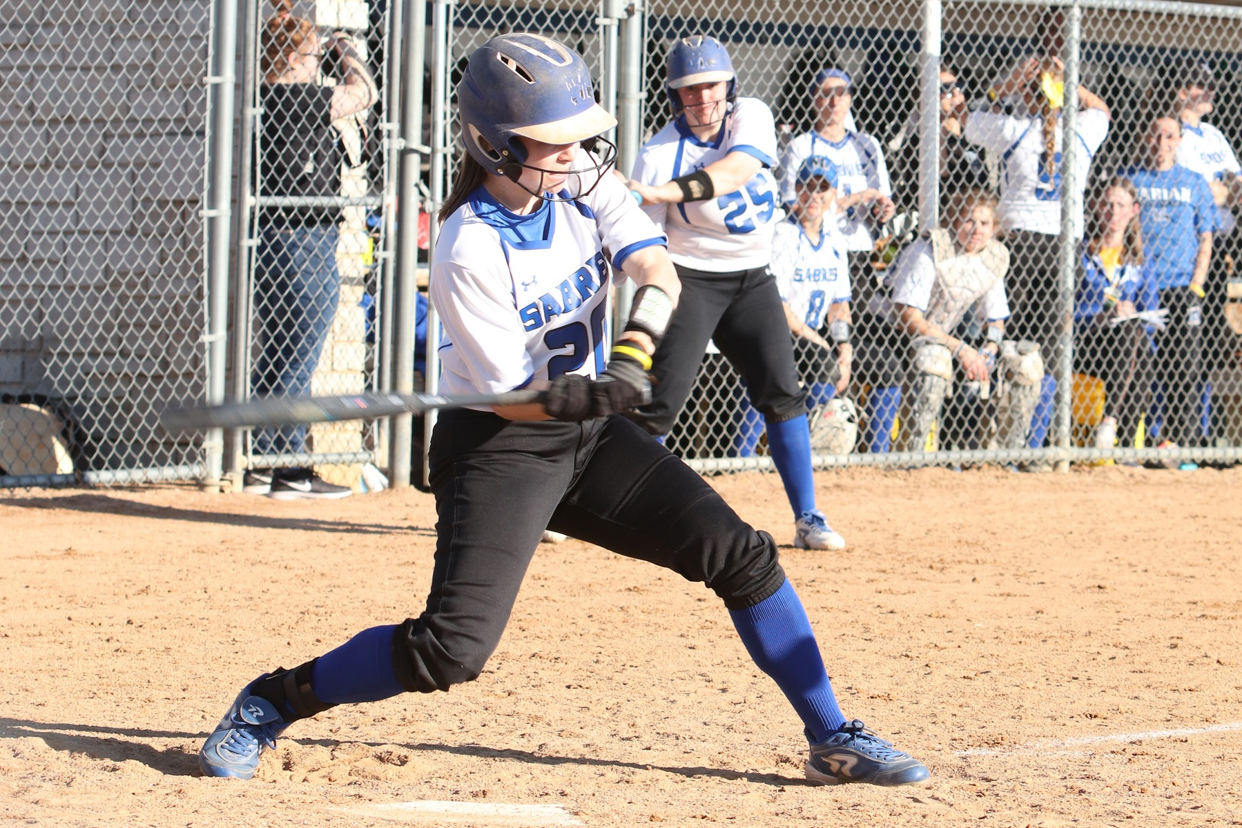 Taylor Lauscher swings.