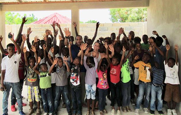 Basketball team with kids in Haiti