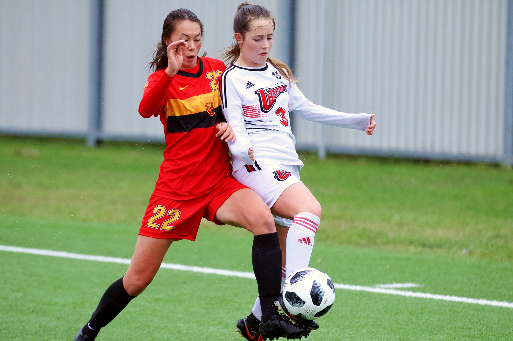 Winnipeg's Alycia Mann (right) battles for a ball with Calgary's Maiya Lee during action Saturday afternoon at the Ralph Cantafio Soccer Complex. (David Larkins/Wesmen Athletics)