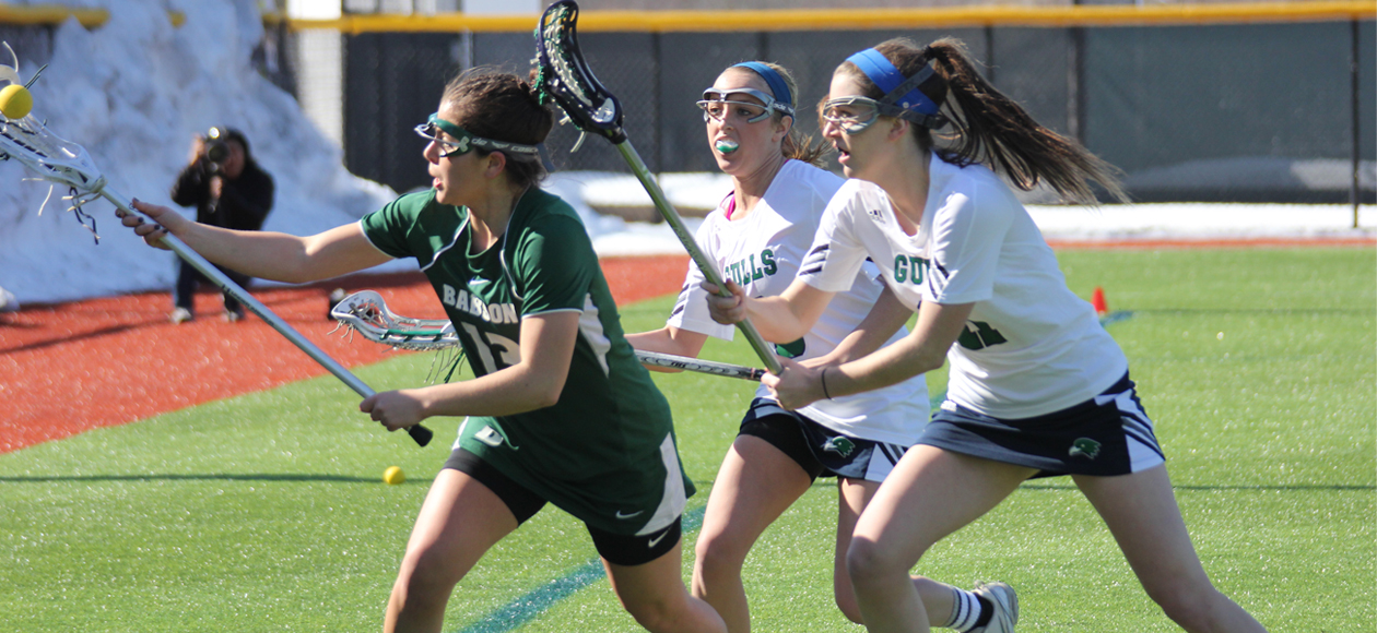 Gulls Defeat Wheaton; Whitney Leads with Four Goals