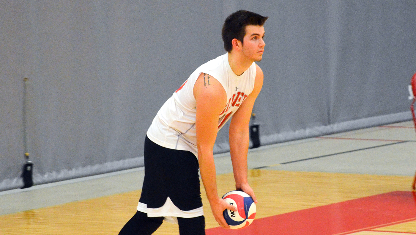 Men's volleyball team comes up short in four-set loss at Adrian