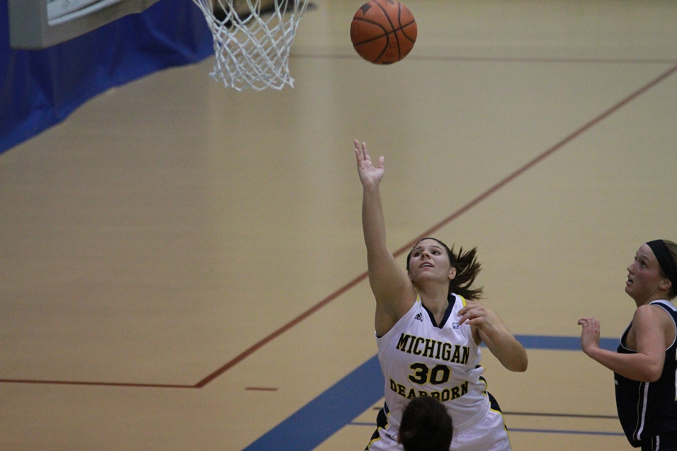 Marisa Sauve goes for a lay-up against Grace Bible
