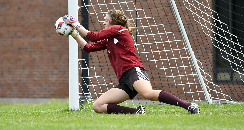 Junior goalie Amanda Manaster makes a save.