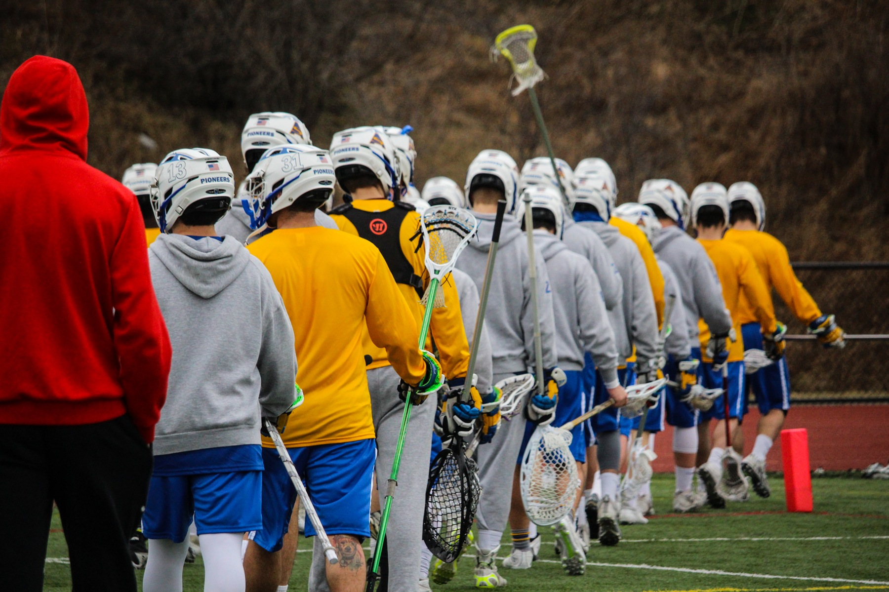 Lacrosse team heads out after warm-ups