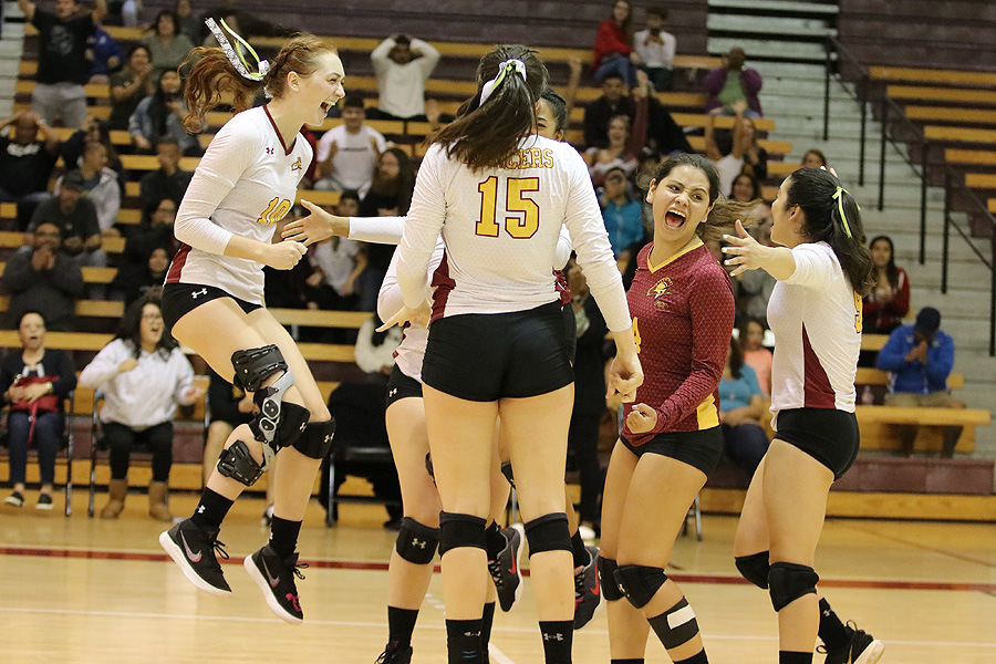 Lancer Danielle Johnson (left) jumps in excitement with her teammates as PCC swept Mt. San Antonio on Saturday, photo by Richard Quinton.