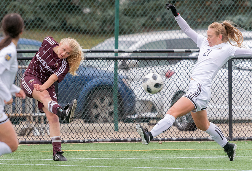 Hannah Supina boots the ball past UBC's Jessica Williams during a 2018 match. The first-year Griffins defender had a terrific campaign, making the U SPORTS all-rookie squad (Chris Piggott photo).