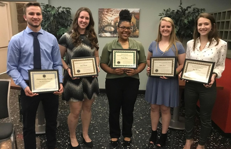 Five SUNY Delhi student-athletes standing with their awards from the Student Leadership awards ceremony.