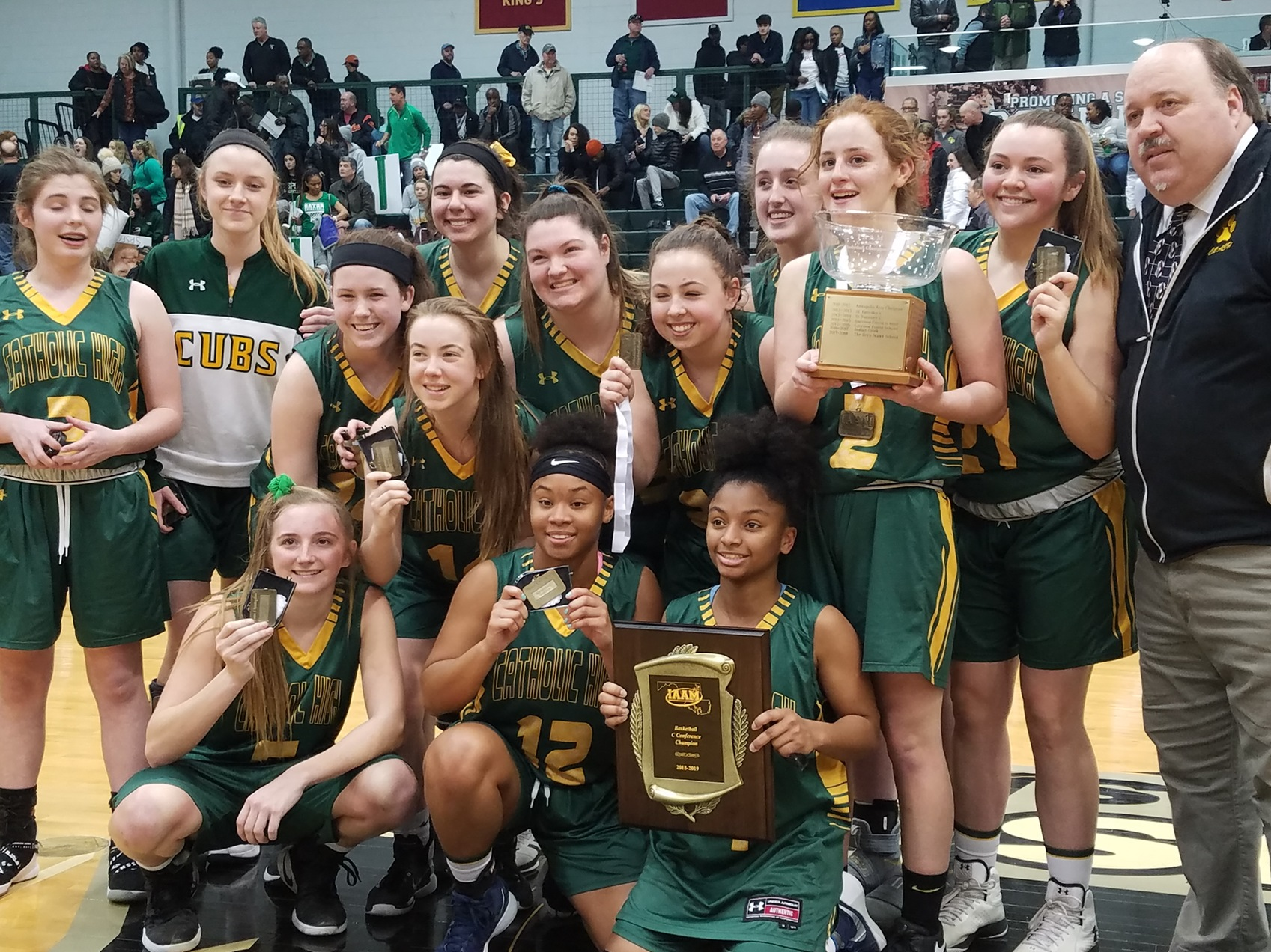 Catholic hoists C Conference basketball trophies