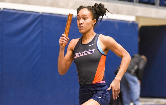 Morgan Love running with the relay baton.