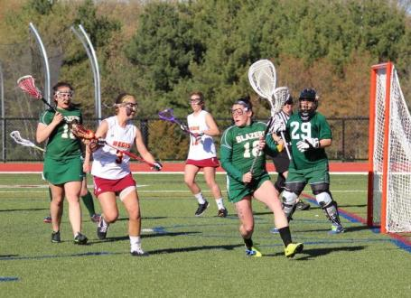 Regis College Advances Past Elms, 20-8, in NECC Women's Lacrosse Semifinal