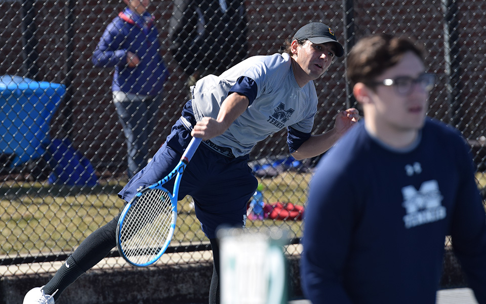 Freshman Daniel Salimnejad serves in doubles action verssu Elizabethtown College on Hoffman Courts.
