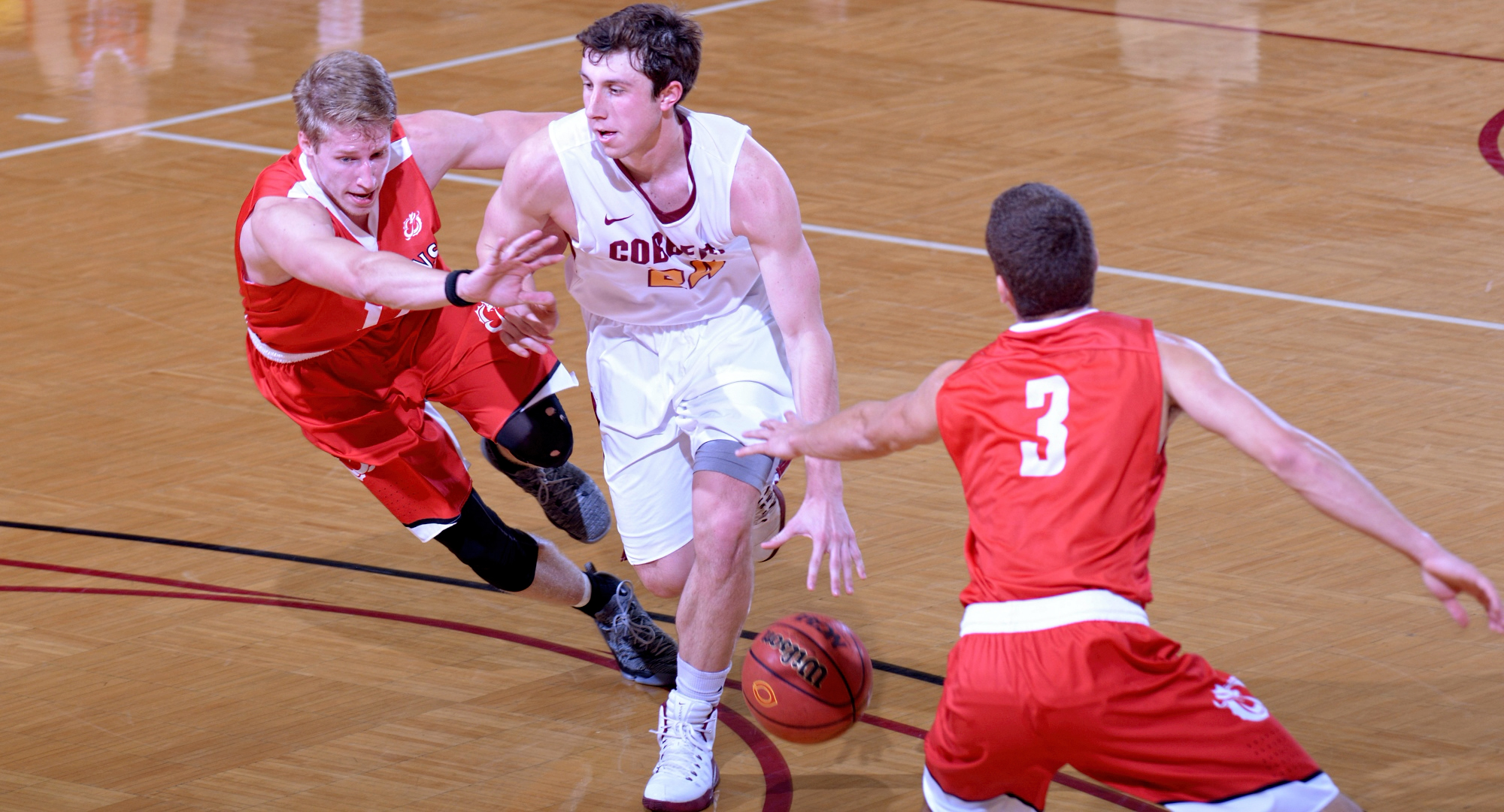 Cobber senior Austin Nelson dribbles by former high school teammate Aaron Lien on his way to the basket in Concordia's game with MSU Moorhead.