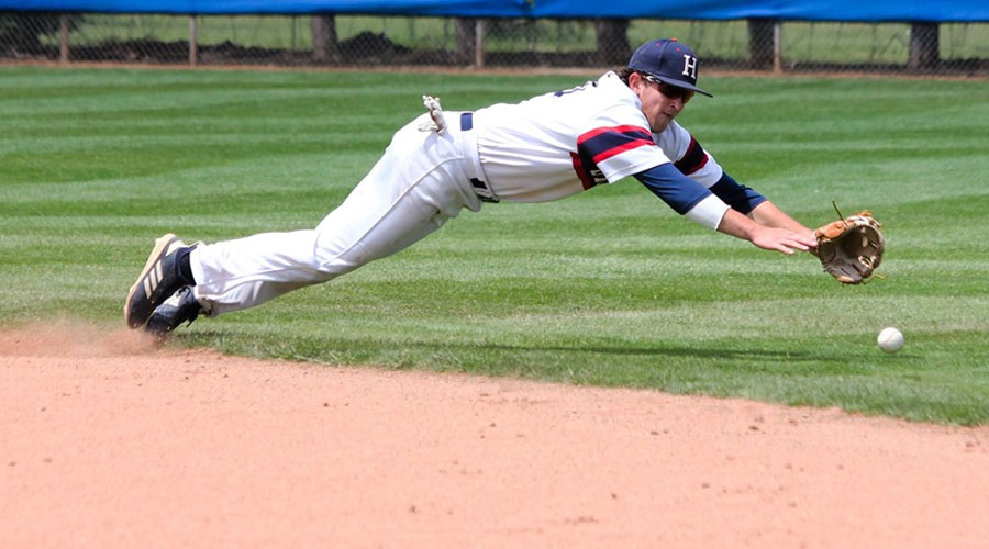 Second baseman Ryan Moritz dives for a ball that sneaks into right field to produce a run in Hutchinson's 4-3 loss to Labette in Game 1 of the Region VI Opening-Round series on Friday at Hobart-Detter Field. (Bre Rogers/Blue Dragon Sports Information)