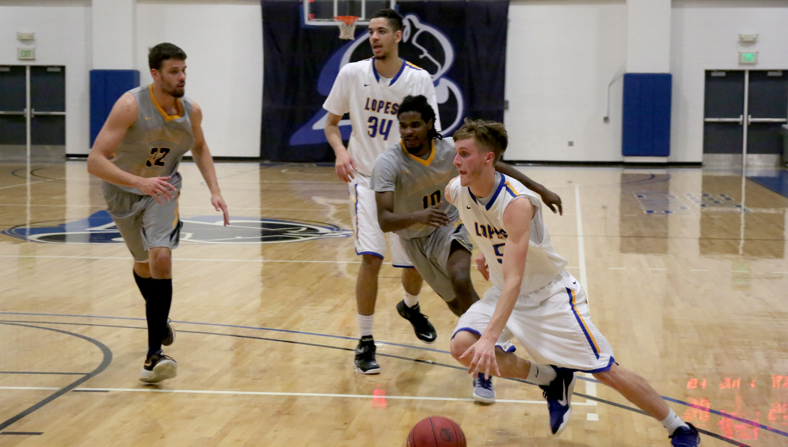 Michael Skinner drives past his defender in action against Laramie County Community College.