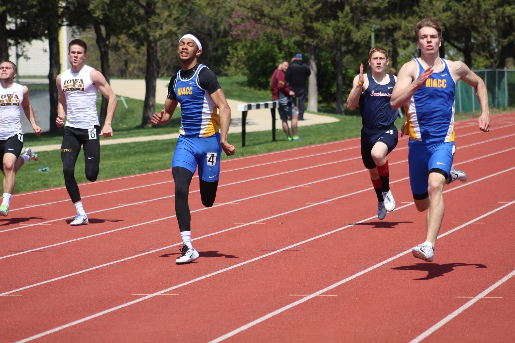NIACC's Brody Goos (right) and Andre McKinney run the 200-meter dash at the Dick Young Invitational Saturday. Goos won in 22.75 and McKinney was third in 22.90.