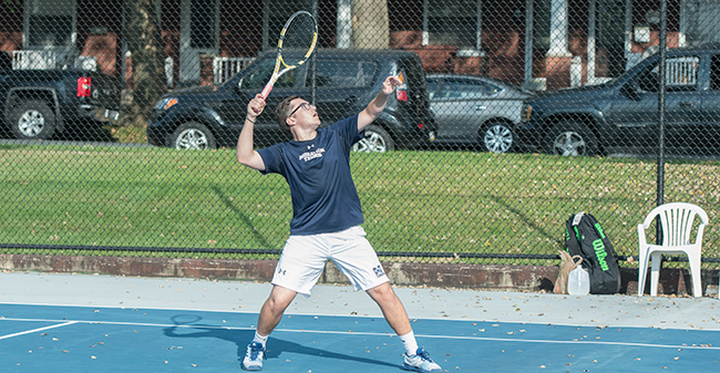 Isaac Schefer '19 returns a shot versus DeSales University at Hoffman Courts in September 2017.