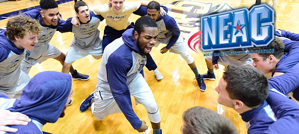 Jamal Garner gets the Gallaudet men's basketball team hype for the game as the team huddles around him in excitement. A NEAC logo is in the upper right corner.