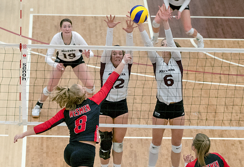 Kylie Schubert and Haley Gilfillan combine to block Winnipeg's Ashleigh Laube during Friday's match. Gilfillan posted a game-high seven blocks (Eduardo Perez photo).