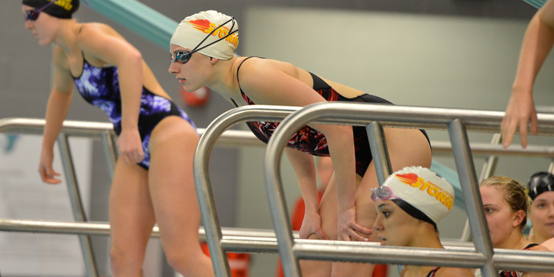 Swimming and diving teams get first wins of 2014-15