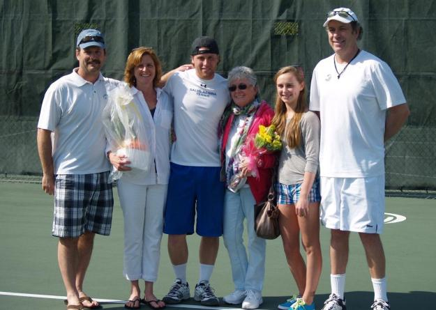 Senior Zachary Rosenfeld is joined by his family and head coach Kevin Pease prior to the match with Assumption College. Rosenfeld won at No. 1 doubles and No. 1 singles to lift the Seahawks to a 6-3 victory over the Greyhounds.