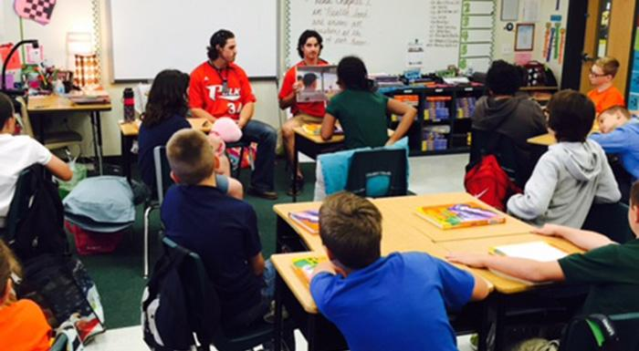 JD Osborne and Brandon Gali read to fifth-grade students at Spessard L. Holland Elementary School in Bartow.