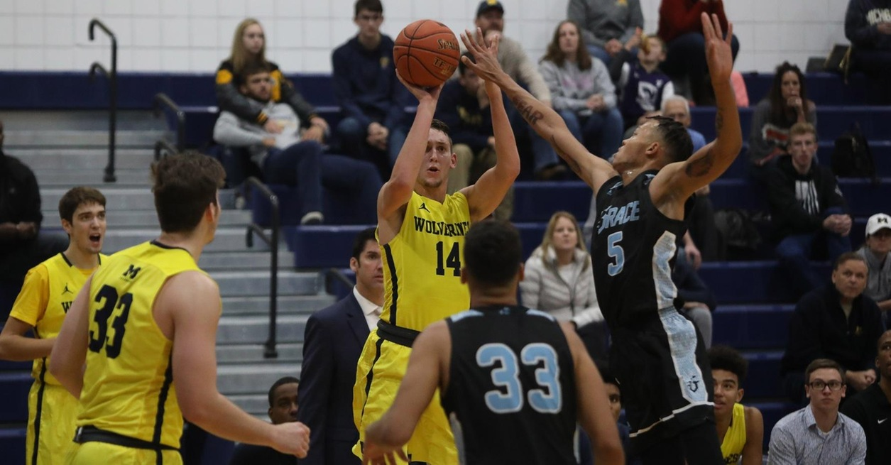 Lattimer's 9 threes pace Wolverines in opening win