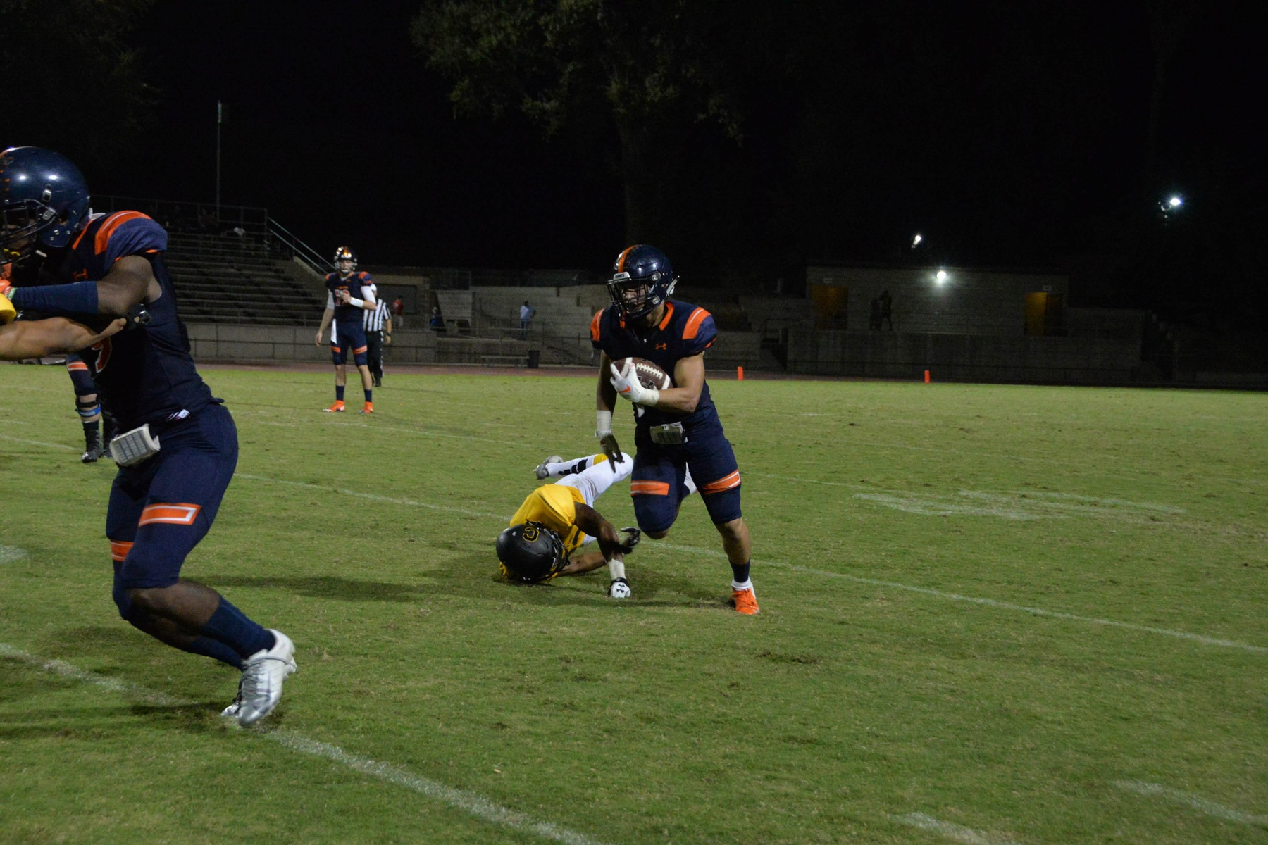 Andrew Azua breaks a tackle vs. Chabot earlier this season.