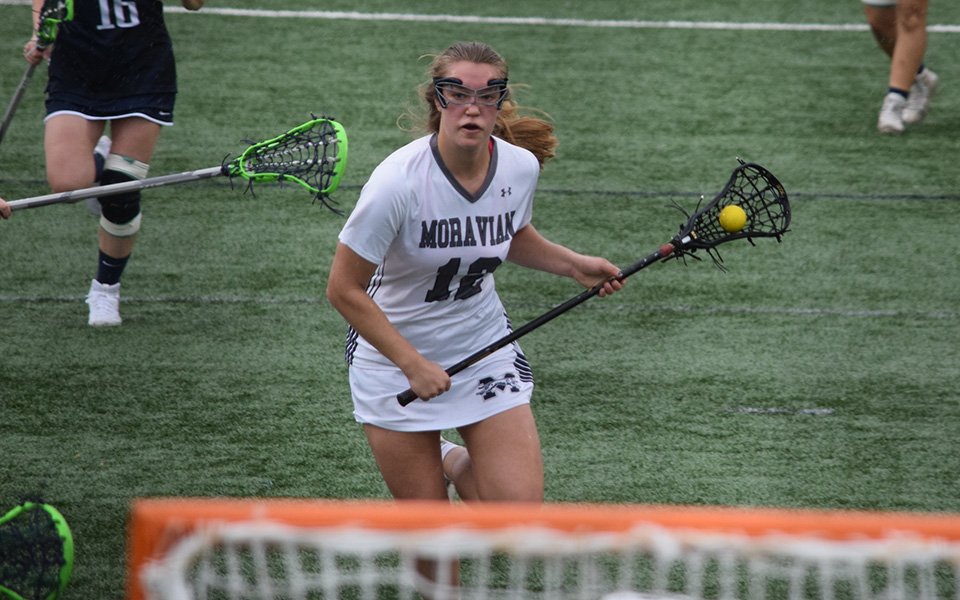 Junior Liz Bill heads towards the net versus Drew University on John Makuvek Field.