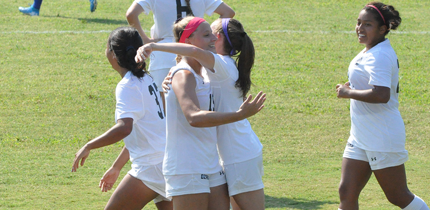 Micaela Winters celebrates a goal with teammates.