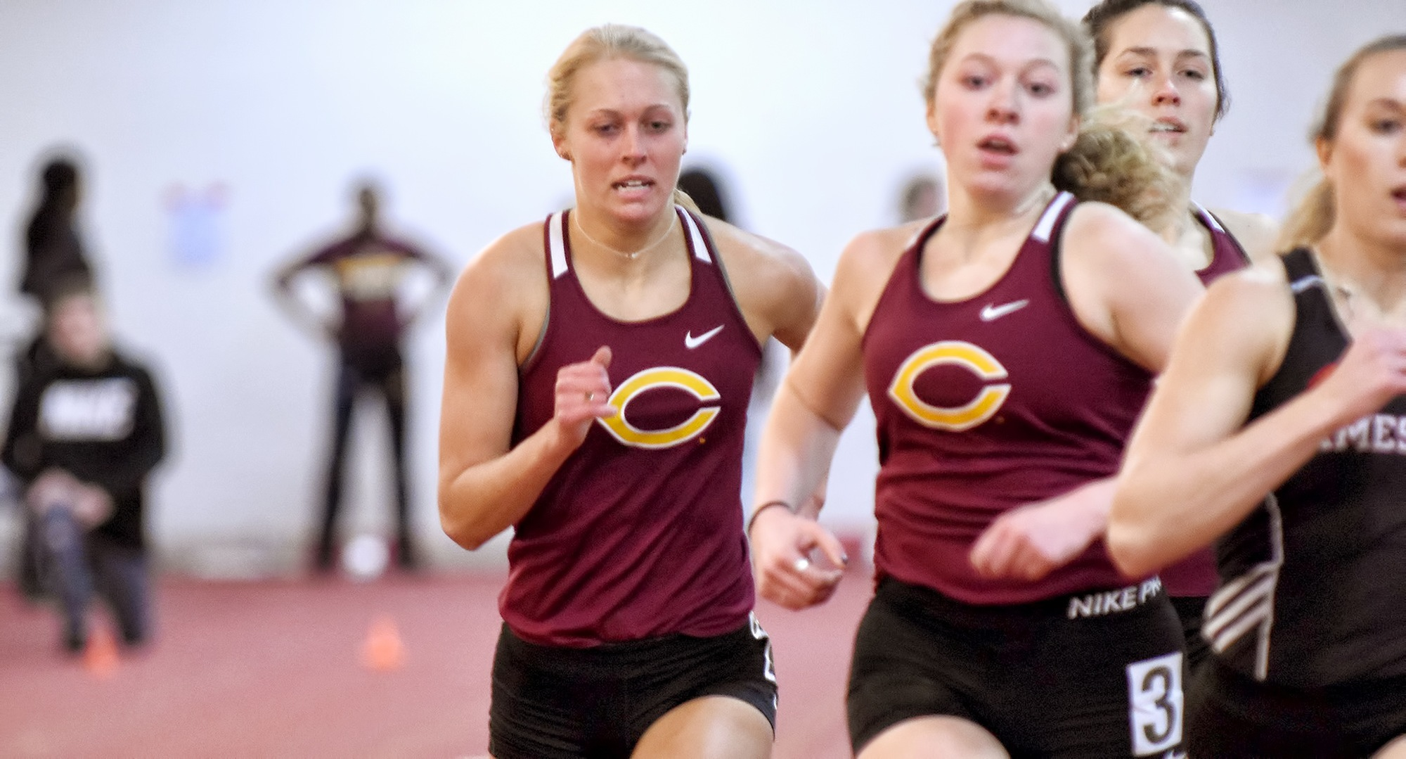 Miriah Forness (L) and Josie Herrmann both put up Top 15 school times in the 800 meters at the UND Tune-Up Meet.