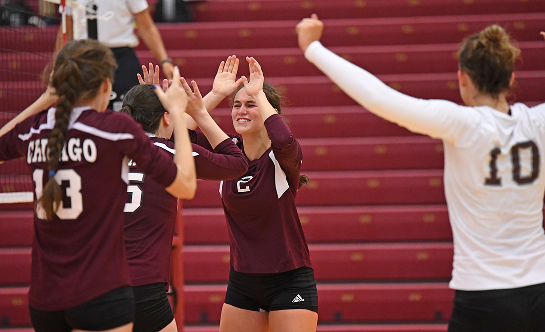 Emma Griffith, center, led the Maroons with 40 assists and five block assists in UChicago's opening win over Wisconsin-Oshkosh Saturday.