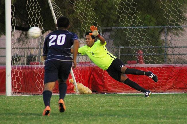 Goalie Brandon Alvarez attempts to block a kick Tuesday night against Pima.
