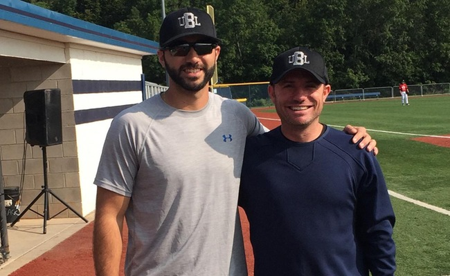 Keith Prestano '13, left, poses with fellow local baseball league owner Joe Bianchi at the Basket Road field in Webster.