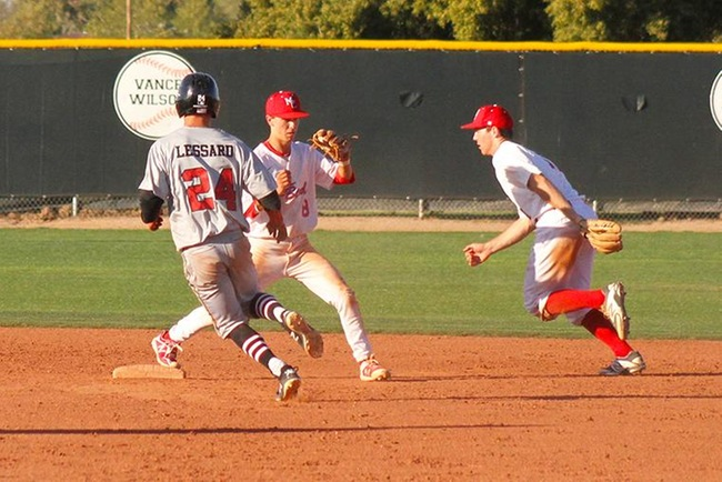 Mesa second baseman Connor Denning flips it to short stop Corey Chaplin for a third out Friday afternoon. (Photo by one of the trainers)