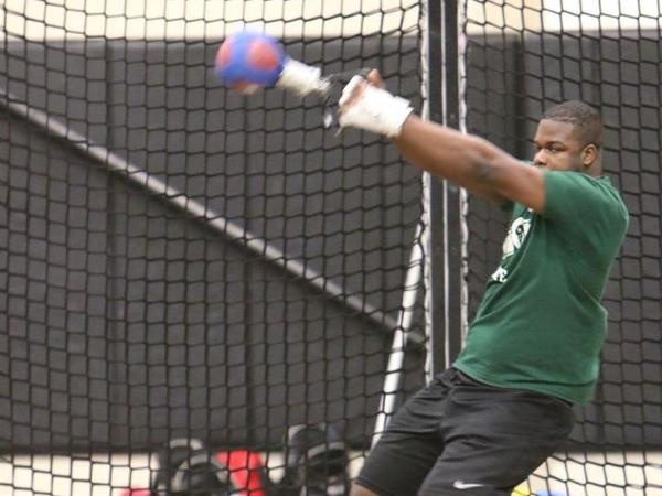 A Rams thrower during competition in the Weight Throw.