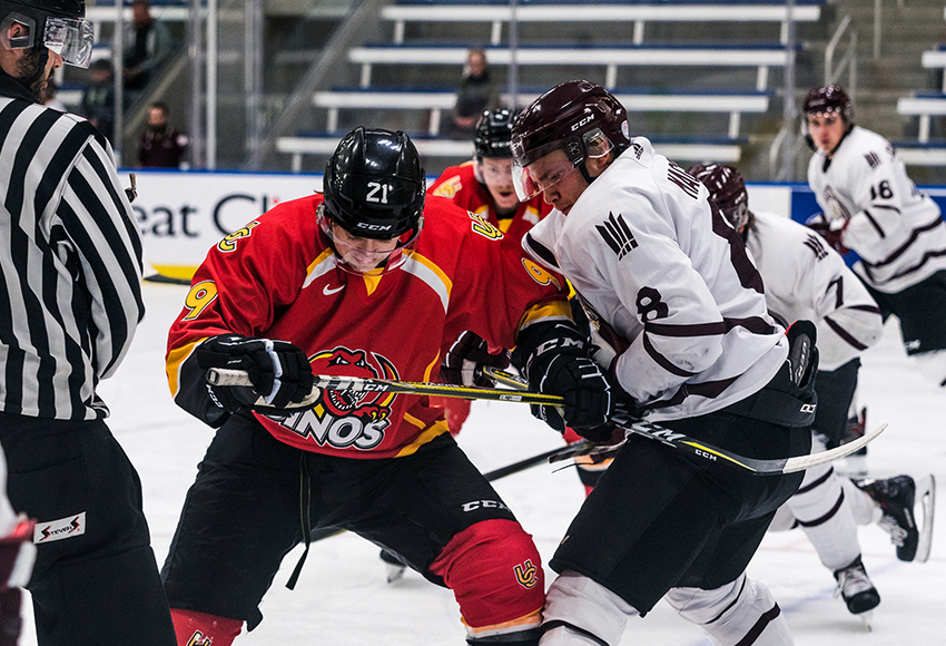 Garan Magnes, seen battling against the University of Calgary during a preseason game, netted a hat-trick in MacEwan's 11-1 win over Briercrest on Saturday (Matthew Jacula photo).